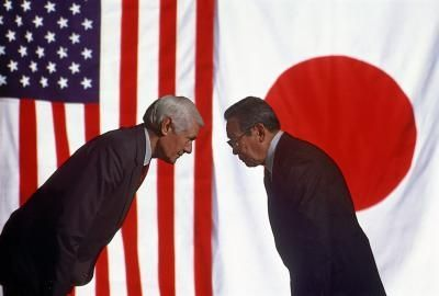An American and a Japanese business person bow to each other